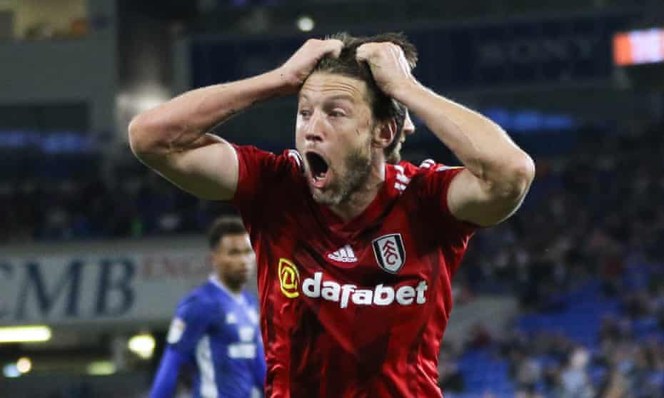 Harry Arter reacts after being shown a second yellow card for simulation, moments after a first for a foul.