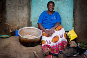 Mary Nasia cooks and sells beans to make a living at the side of the road in Kibera.