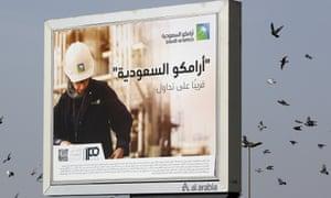 A billboard advertisement in Jiddah, Saudi Arabia, reads: 'Saudi Aramco, soon on stock exchange.'