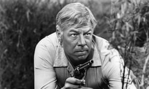 George Kennedy in a scene from the film Guns Of The Magnificent Seven, 1969.