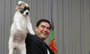 Berdymukhamedov holds up an alabai puppy