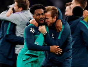 Tottenham's Danny Rose and Harry Kane, missing through injury, join in the celebrations