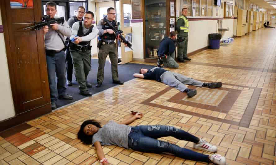 Law enforcement and first responders from Cumberland and York Counties participate in a regional active shooter training at Deering High School, Portland, Maine.