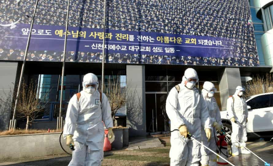 Coronavirus outbreak: the area around a branch of the Shincheonji Church of Jesus in Daegu is disinfected on Thursday.