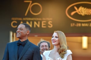 US actor and member of the Feature Film jury Will Smith (L) and US actress and member of the Feature Film jury Jessica Chastain pose as they arrive