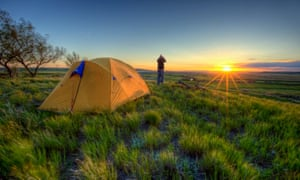 Person looking through binoculars and camping in Grasslands National Park, Saskatchewan, Canada.