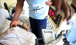 A nurse tends to patients on a general ward at the Queen Elizabeth hospital, Birmingham