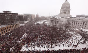 An estimated 70,000 to 100,000 demonstrators rally outside the capitol building protesting against restrictions on collective bargaining for government workers on 26 February 2011 in Madison, Wisconsin.
