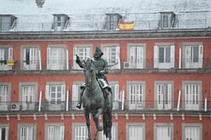 The statue of King Philip III of Spain, covered by snow in the Plaza de Mayor, Madrid, on Friday.