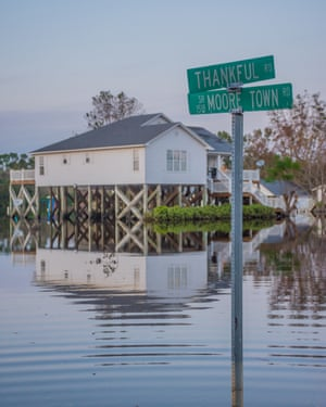 A home on stilts narrowly escapes the flooding on the corner of Thankful Road in Rocky Point.