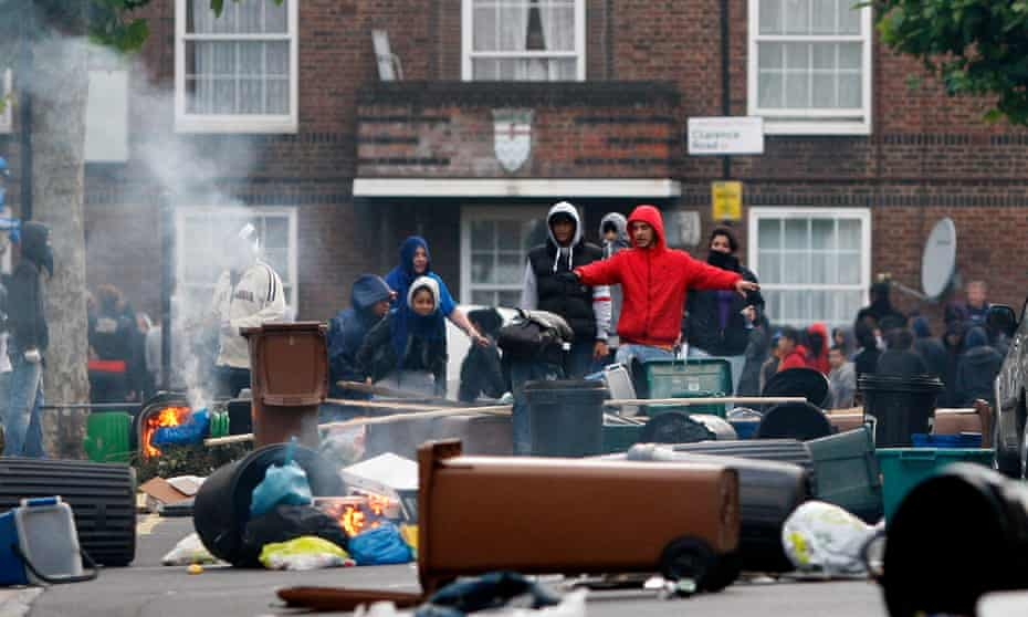 Young people construct barricades in London during the August 2011 riots.