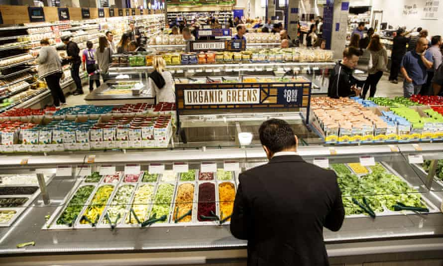 A customer builds a salad at a supermarket in Los Angeles