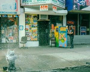 A man uses a community fridge in the Bronx.