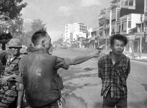 Gen. Nguyen Ngoc Loan, South Vietnamese chief of the national police, fires his pistol into the head of suspected Viet Cong official Nguyen Van Lem on a Saigon street early in the Tet Offensive, February 1, 1968