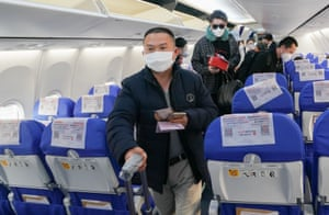Passengers board a China Eastern Airlines flight at Tianhe airport