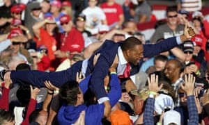 Vernon Jones crowdsurfs during a campaign rally for Donald Trump at Middle Georgia regional airport in Macon, Georgia, on Friday.