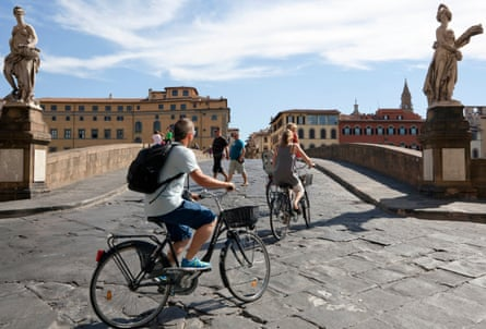 Bikes over Ponte Santa Trinita in Florence.