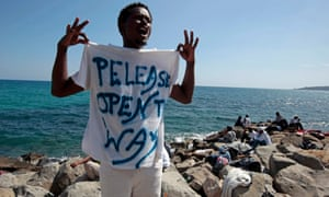 An Eritrean migrant tries to gt into France after being blocked by border police.