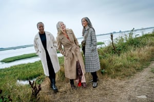From left, Judith wears cream coat, top and trousers all asos.com, and boots joseph-fashion.com. Jane wears belted coat, french connection.com, shirt, asos.com, and black boots, rejinapyo.com. Kahti wears plaid coat, stories.com, and roll neck, asos.com