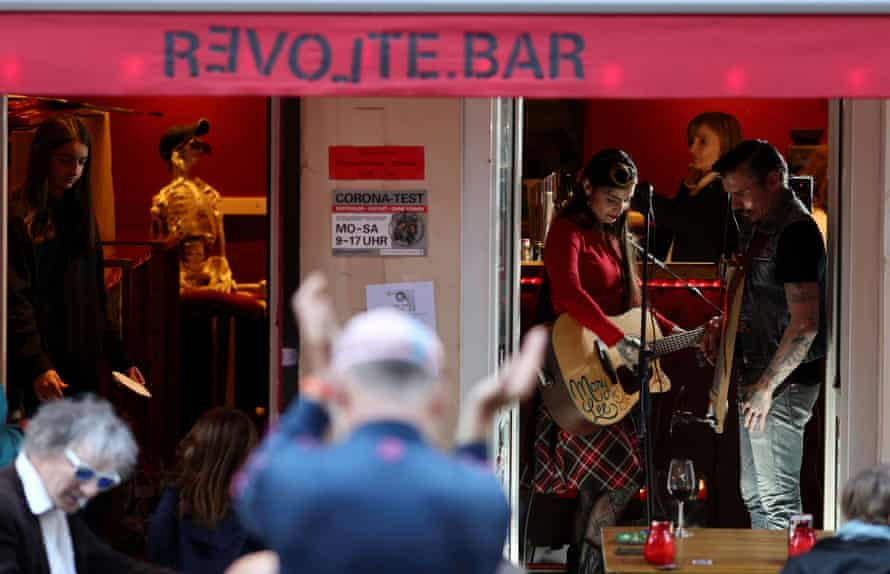 Artists perform at Revolte bar in Berlin, as cafes, bars and restaurants reopen their terraces after a Covid lockdown, May 2021