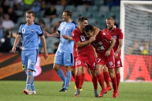 Nikola Mileusnic celebrates with Ben Garuccio after scoring Adelaide United's equaliser in the FFA Cup final against Sydney FC.