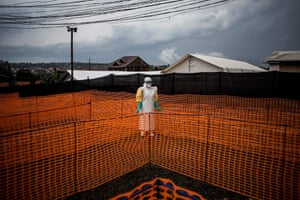 A health worker waits to handle a new patient at an Ebola treatment centre in Bunia, Democratic Republic of the Congo.