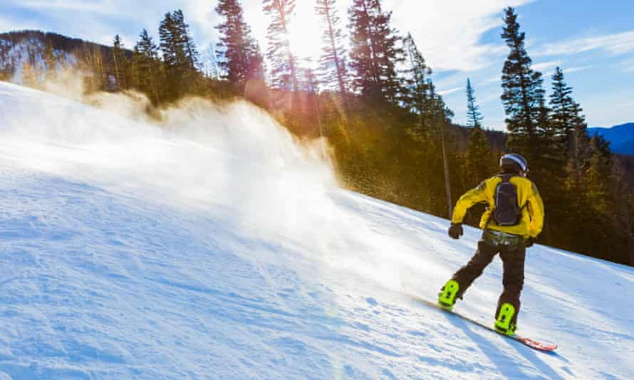 Teenager snowboarding in Taos, New Mexico