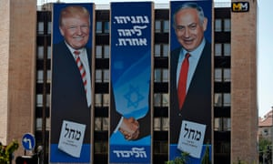 An Israeli election banner for the Likud party showing Donald Trump shaking hands with Benjamin Netanyahu hangs on a building in Jerusalem.