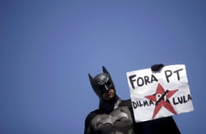 """<strong>Copacabana, Rio de Janeiro </strong>A demonstrator in a Batman costume. The banner reads """"Out PT (Workers Party), Dilma and Lula"""""""