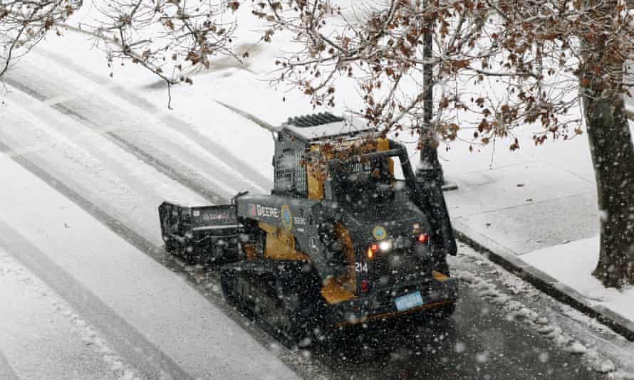A snow-clearing machine cleans a road in Marlborough, Massachusetts on Saturday.