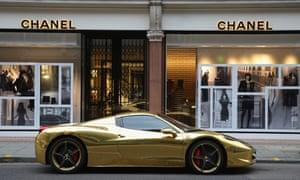 A gold Ferrari parked on a London street