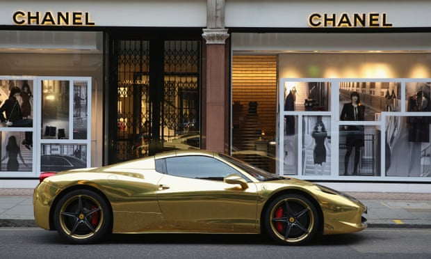 A gold Ferrari is parked outside Chanel in London