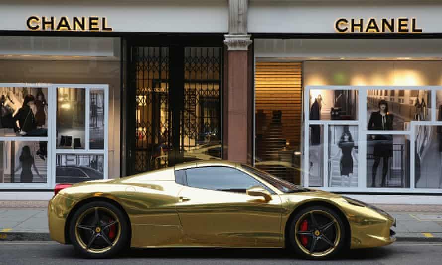 A gold Ferrari sits outside Chanel in Sloane Street, London
