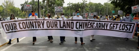 Demonstrators hold a banner during a protest against China in Delhi on 19 June.
