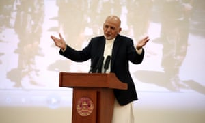 The Afghanistan president, Ashraf Ghani, addresses Afghan security forces in Kabul on Monday. He was excluded from and opposed to the US-Taliban deal.