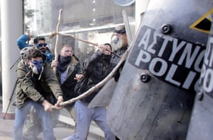 Riot police used shields to defend themselves