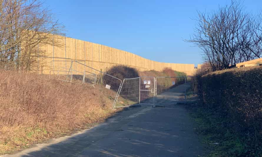 Residents say the 15-foot fence has destroyed sweeping country views.