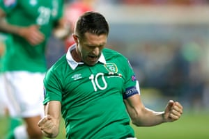 Robbie Keane celebrates after scoring the third from the penalty spot.