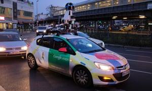 a google street view car in evening traffic in kreuzberg berlin in 2017