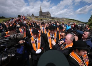 Orangemen march to police lines outside Drumcree parish church in Portadown on 4 July 2010.