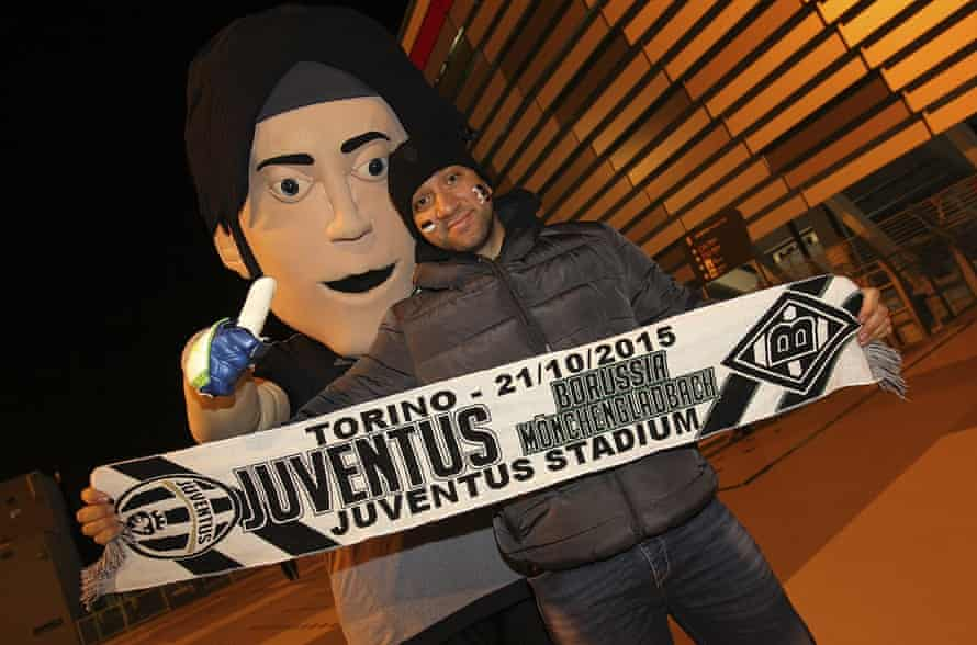 A Juventus fan with a half and half scarf.