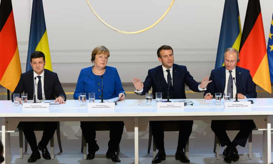 Volodymyr Zelensky, Angela Merkel, Emmanuel Macron and Vladimir Putin during a press conference after the summit.