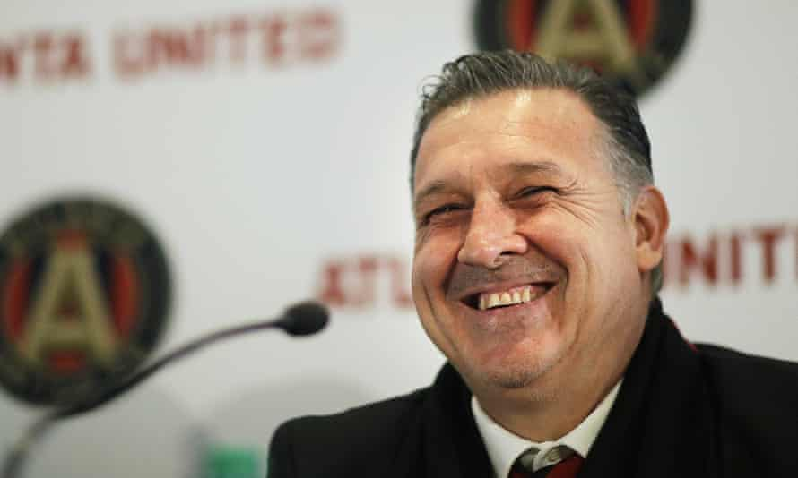 Gerardo Martino smiles as he's introduced to the press in the week.