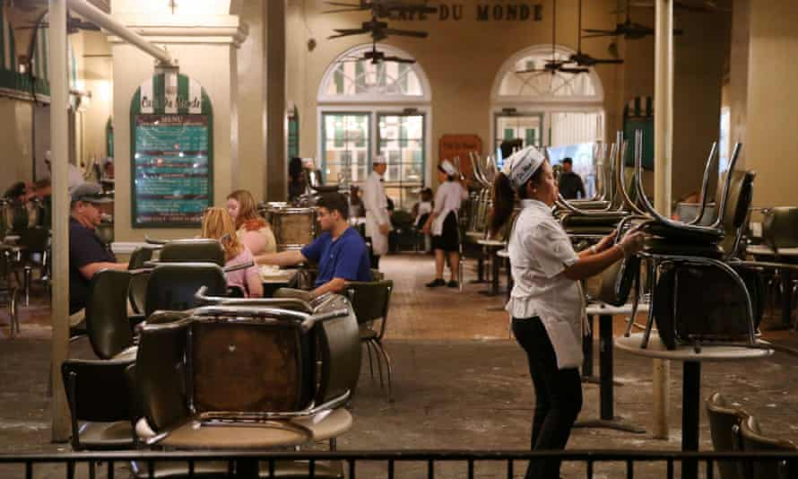 Myra Luna Antonio closes Cafe Du Monde in New Orleans. The restaurant discontinued its seating service to comply with coronavirus related restrictions.