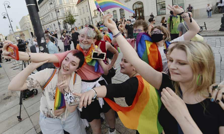 People with rainbow flags take part in a flashmob in front of the presidential palace in Warsaw.