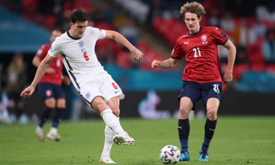 Harry Maguire plays a pass as Alex Kral closes in during England's 1-0 win against the Czech Republic.