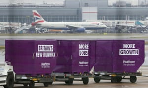 Cargo containers near runway at Heathrow