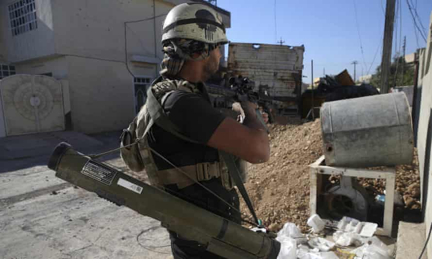 An Iraqi special forces soldier fighting Isis militants in Mosul.