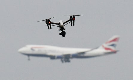 A file photo of a drone and an aircraft