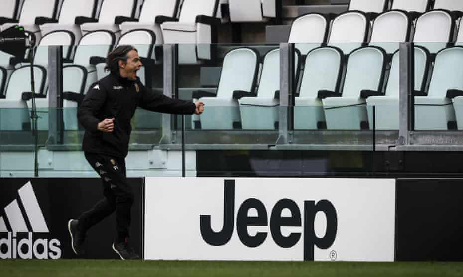 Benevento coach Filippo Inzaghi shoots down the sideline to celebrate the Juventus win.